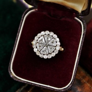 An exceptionally fine Triangular-Cut Diamond Cluster Ring set in 18ct Yellow Gold and Platinum tipped, Circa 1930