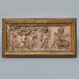 An 18th century English rectangular terracotta plaque, depicting the marriage of Cupid & Psyche