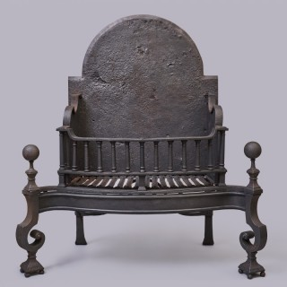 A n 18th century English George II wrought iron firegrate