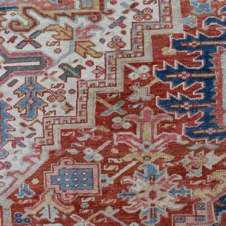 An Old Heriz roomsize carpet 355x214cm