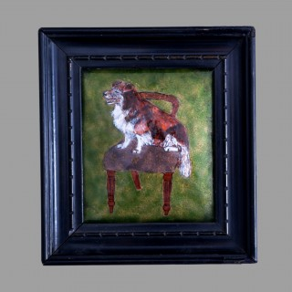 An arts and crafts enamel plaque: Dog on chair