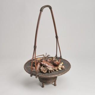 An elaborate Japanese, Meiji-era bronze and multi-metal basket of seafood Signed Joun