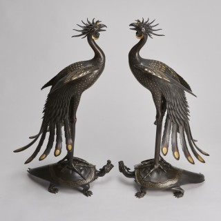 An exceptional pair of multi metal Phoenixes mounted on turtles (Japanese, 1868 - 1912)