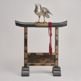 A majestic, life-size silvered Bronze Okimono of a Hawk on a superb lacquer stand, (Japanese Meiji-era)