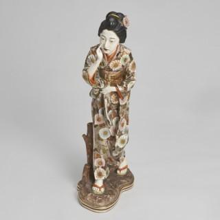 An elegant Japanese Meiji-era Satsuma figure of a Bijin