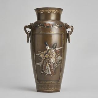 An exquisite Japanese Bronze and multi metal vase depicting a Samurai Archer