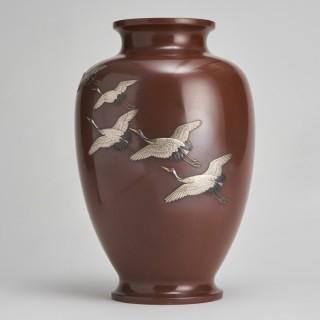 A large Japanese Meiji-era Bronze vase depicting Cranes