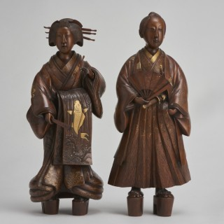 A pair of very finely carved Japanese wood figures (1868-1912)