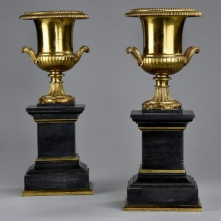Highly decorative pair of French late 19thc brass campana urns on slate bases