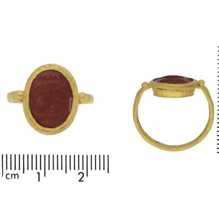 Ancient Roman gold ring with intaglio of imperial eagle and standards, circa 1st-2nd century AD.