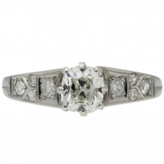 Old mine diamond flanked solitaire ring, circa 1910.