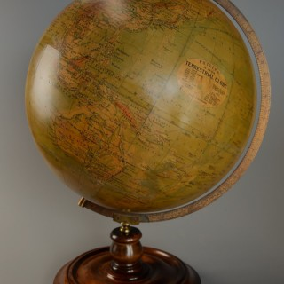 Early 20thc Philips 19 inch terrestrial table globe supported on walnut base