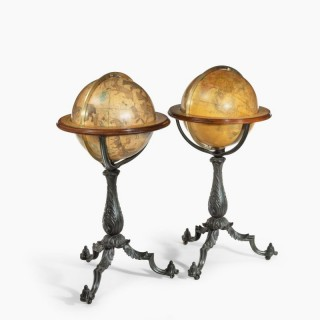 A Pair of 16-inch floor standing globes by Gilman Joslin