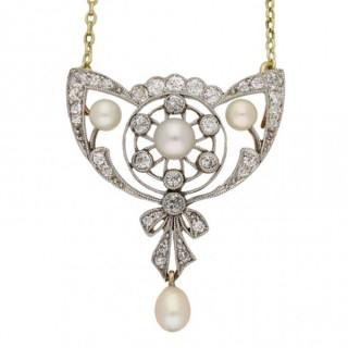 Edwardian natural pearl and diamond brooch/pendant, English, circa 1900.
