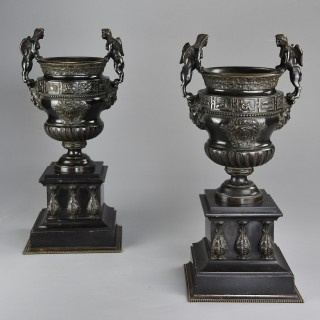Pair of late 19thc bronze urns after a design of a pair of urns at The Palace of Versailles
