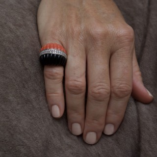 Coral and onyx ring