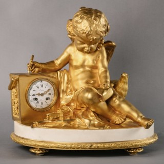 A Large Louis XVI Style Gilt-Bronze and White Marble Figural Mantel Clock