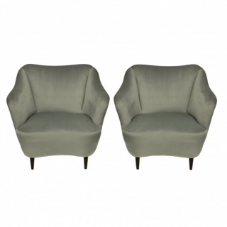 A PAIR OF MID CENTURY COCKTAIL CHAIRS