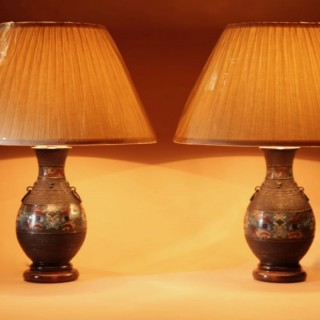A Pair Of Decorative Champlevé Japanese bronze vases now fitted as a table lamps.