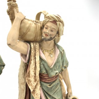 PAIR OF ROYAL DUX BOHEMIA PORCELAIN FIGURES OF AN EASTERN WATER BEARER AND HIS COMPANION