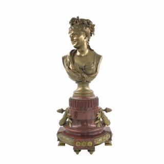 A BRONZE BUSTE OF A LADY BY LEOPOLD HARZÉ