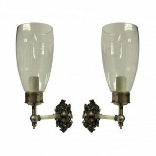 A PAIR OF WALL SCONCES WITH STORM SHADES