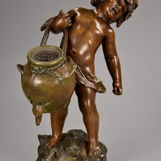 Late 19th century French spelter figure of young male water carrier