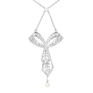 1.29ct Diamond and Pearl, Platinum Bow Pendant - Antique Circa 1900