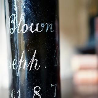 An Unusual Victorian Engraved Blue Glass Wine Bottle; 'Blown by Joseph Brown 1879'
