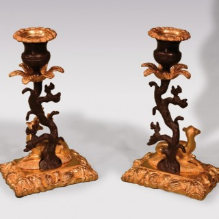 Pair of 19th century bronze and ormolu stag and deer candlesticks