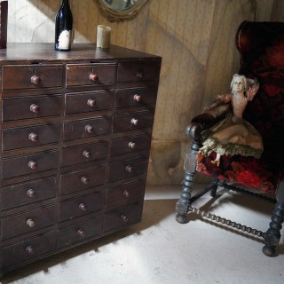 A Late 19thC Stained Pine Bank of Twenty-One Drawers c.1890