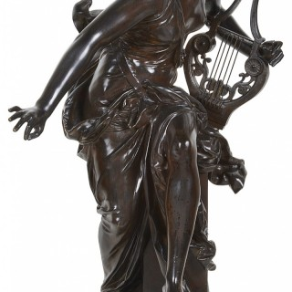 Carrier-Belleuse bronze female statue holding a harp, 'Harmone' 19th Century.