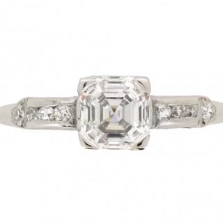 Asscher cut diamond flanked solitaire ring, circa 1925.