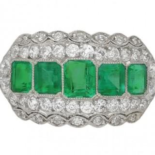 Art Deco five stone emerald and diamond cluster ring, circa 1935.