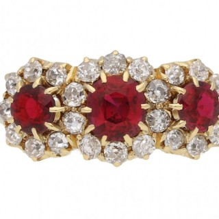 Edwardian ruby and diamond triple cluster ring, English, circa 1905.