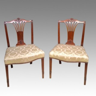 A pair of Chippendale  carved mahogany side  chairs.