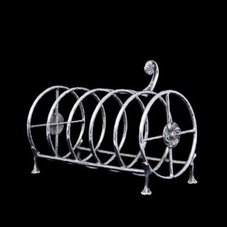 An A E Jones silver arts and crafts toast or crumpet rack