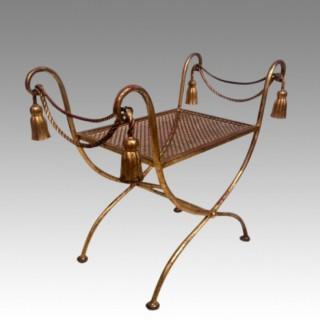 Italian Romanesque gilded metal stool.