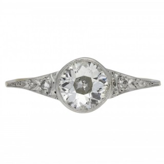 Edwardian diamond flanked solitaire ring, English, circa 1915.