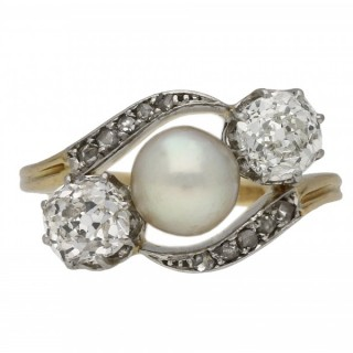 Belle Époque pearl and diamond three stone cross over ring, circa 1915.