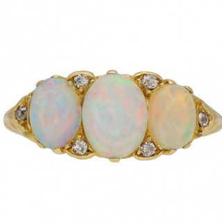 Antique opal three stone carved ring, English, circa 1900.
