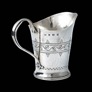 A Bernard Cuzner arts and crafts silver milk jug
