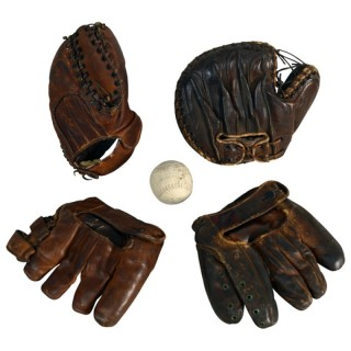 Four vintage baseball leather mitts and one ball