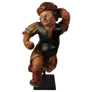 Wood carving of a nano running, North Italy, early 17th century