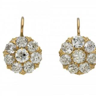 Diamond coronet cluster drop earrings, circa 1890.
