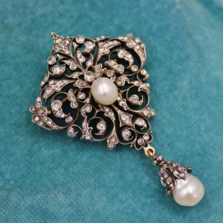 An exceptionally finely worked Natural Pearl & Diamond Brooch/Pendant set in 18ct Yellow Gold & Silver, French, Circa 1870