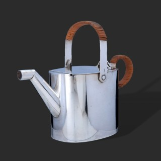 A Christopher Dresser silver plated hot water can for Hukin and Heath
