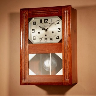 An Art Deco Westminster Girod Carillon Oak, Rosewood and Fruit Wood Wall Clock French circa 1940