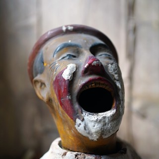 A Rare Early 20thC Painted Plaster Laughing Clown Fairground Ball-Toss Game c.1910-20