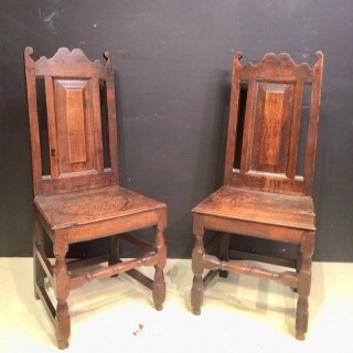 Pair of Welsh Queen Anne oak side chairs.